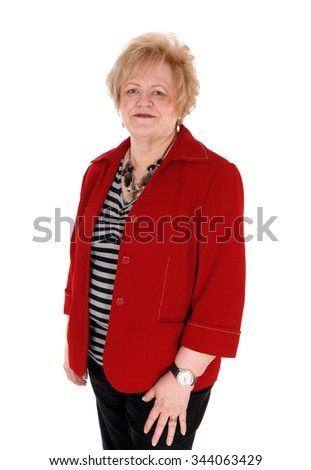 A lovely older blond woman in a red jacket and black pants standingisolated for white background. - stock photo