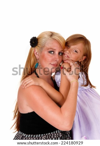 A lovely picture a mother hugging her little daughter, looking into the camera, isolated for white background.  - stock photo