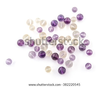 A lovely pile of ametrine and amethyst beads in purple, violet and yellow colors. - stock photo