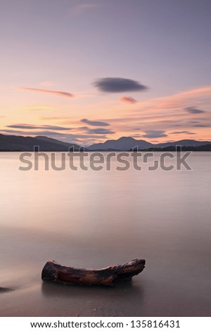 A lovely Sunset by Loch Lomond with Ben Lomond mountain in the background, Scotland - stock photo