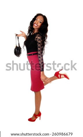 A lovely tall slim African American woman in a red skirt and black blouse
