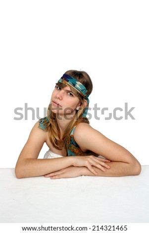 A lovely teenage girl wearing a colorful headband.  Isolated on a white background with generous copyspace.  - stock photo