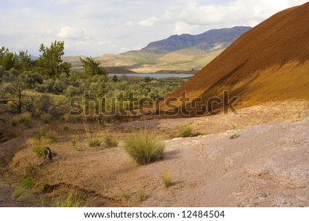 A lovely view of part of the Painted Hills in Oregon with an ancient Rhyolite lava flow in the foreground. - stock photo