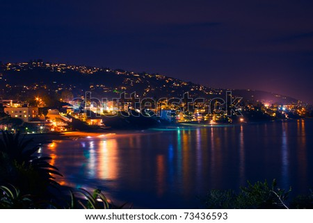 A lovely view of the popular California destination of Laguna Beach, as viewed at night from a distance. - stock photo
