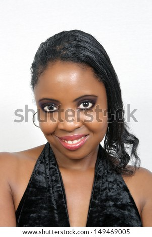 A lovely young black woman with a radiant smile.