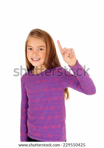 A lovely young blond girl pointing with her finger up, telling the teacher know something, isolated on white background.  - stock photo