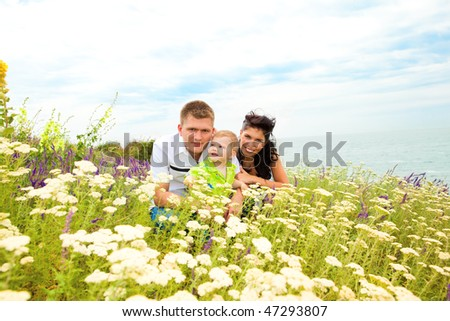 A lovely young family in the outdoors - stock photo