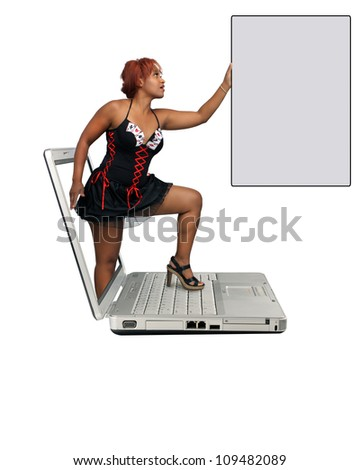 A lovely young redhead steps out of a laptop computer screen, holding a gray card with plenty of space for your message.  Isolated on a white background with generous copyspace. - stock photo