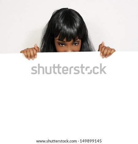 A lovely young woman holds a blank white sign. - stock photo