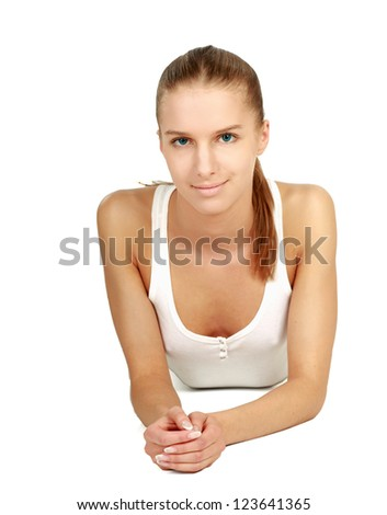 A lovely young woman lying on the floor - stock photo