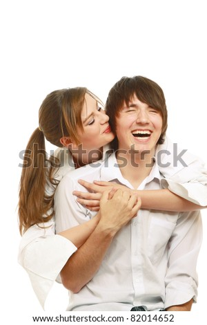 A loving couple embracing isolated on white - stock photo
