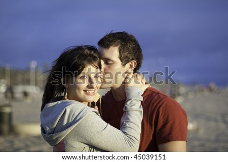 A loving couple spending an afternoon at the beach - stock photo