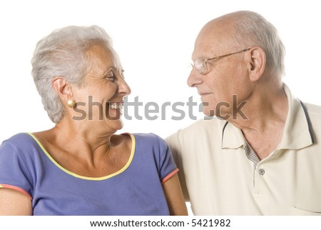 A loving, handsome senior couple on a white background - stock photo