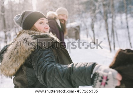A loving happy young couple emotionally runs in the winter woods. Close-up - stock photo