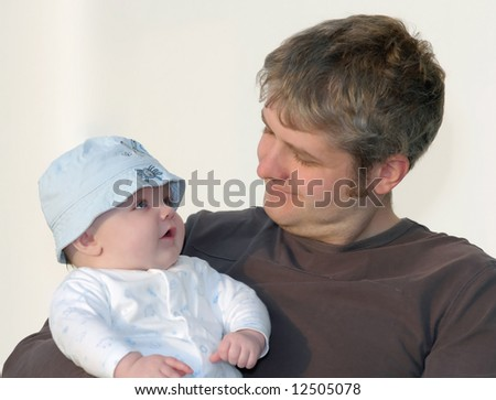 a loving look between father & son - stock photo