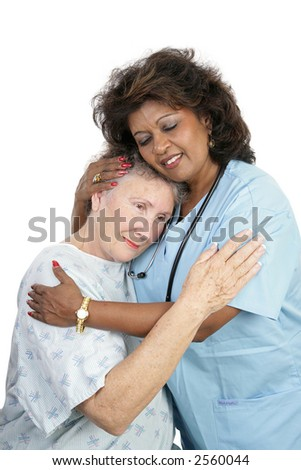 A loving medical professional comforting an elderly woman.  Isolated on white. - stock photo