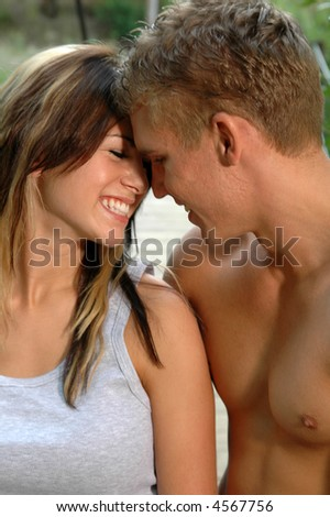 A loving your couple kissing in the countryside