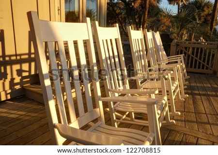 A low angle of rocking chairs on the deck outside of a luxury Atlantic Ocean beach house in Hilton Head, SC.