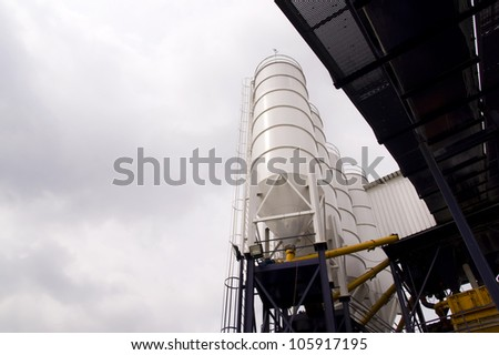 A low angle shot of white industrial silos with conveyor belt - stock photo