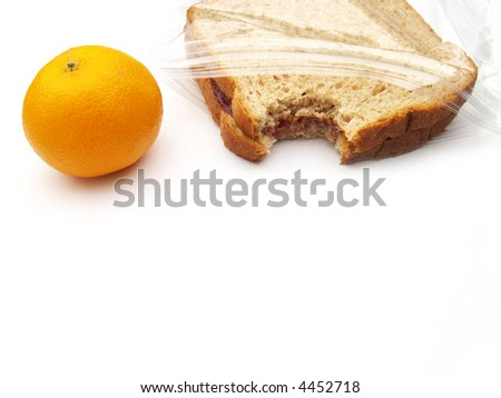 a lunch on the go - orange and peanut butter and jelly sandwich - stock photo