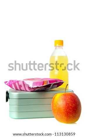 a lunchbox, with an apple and juice - stock photo