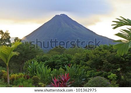 A lush garden in La Fortuna, Costa Rica with Arenal Volcano in the background - stock photo