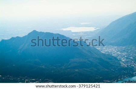 a lush green mountain photographed from Piani d'Erna (part of the Alps) near Lake Como in Italy - stock photo