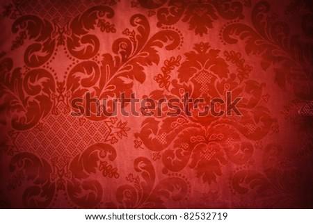 A lush red sofa pattern of swirls - stock photo