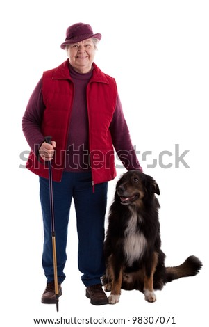 A lusty female senior with dog looks to viewer - stock photo