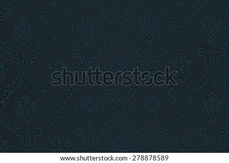 a luxurious seamless pattern of flowers on a dark blue fabric - stock photo