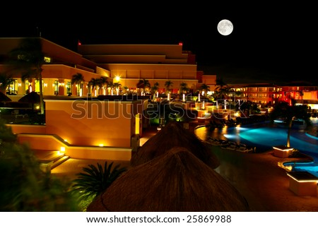 a luxury all inclusive beach resort at night in Cancun Mexico - stock photo