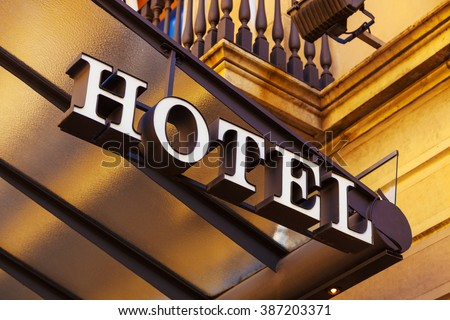 A luxury hotel entrance with sign. - stock photo