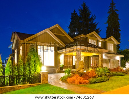 A luxury house in suburbs at dusk in Vancouver, Canada - stock photo
