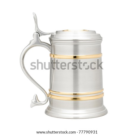 A luxury pewter beer mug decorated by golden - stock photo