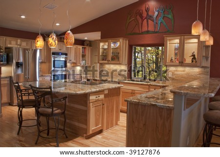 A luxury remodeled kitchen with granite countertops and stainless steel appliances - stock photo