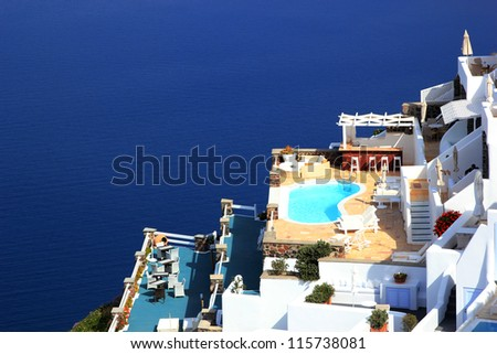 A luxury swimming pool situated in the town of imerovigli on the greek island of santorini - stock photo