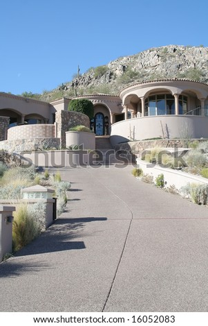 A luxury upscale home in an Arizona desert suburb - stock photo
