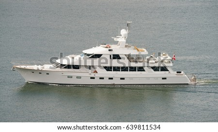 A luxury white motor yacht out at English bay Vancouver Canada