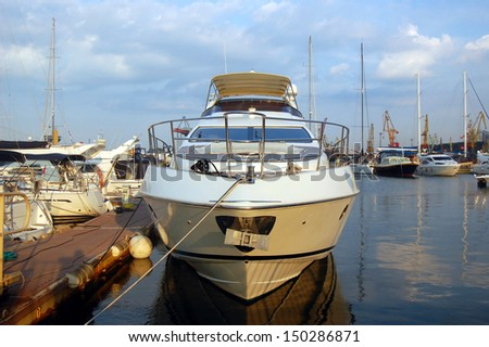 A luxury yacht at the yacht club on a summer evening. - stock photo