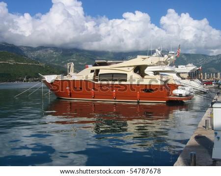 A luxury yacht moored in marina. - stock photo