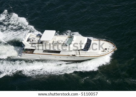 A luxury yacht travelling at speed through the Pacific. - stock photo