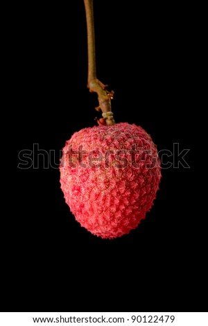 A lychee against a black background - stock photo