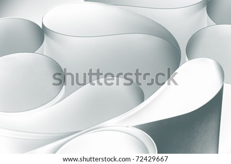 a macro, abstract, background picture of white sheets of paper, wavy, twisted, curved shapes. - stock photo