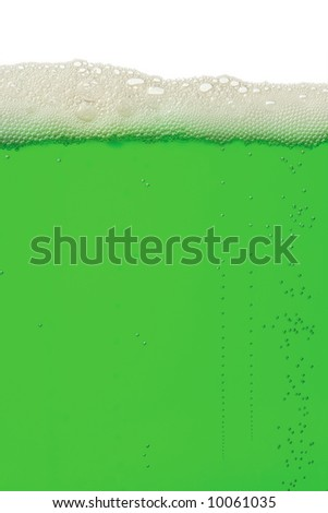 A macro background image of green beer for St. Patrick's Day. - stock photo