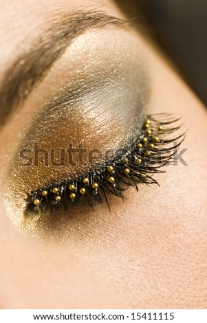 A macro close up of a beautiful woman's made up eye with false eyelashes - stock photo