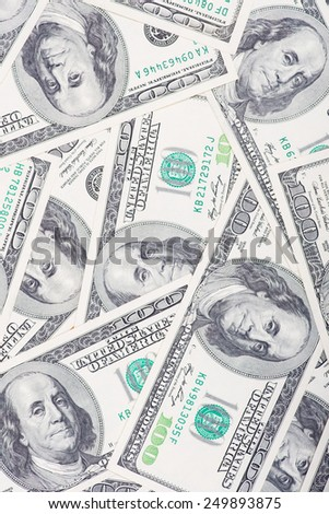 A macro close-up of a messy carpet of 100 US$ money notes. - stock photo