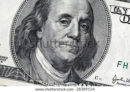 A macro image of Benjamin Franklin on the United States $100 Bill
