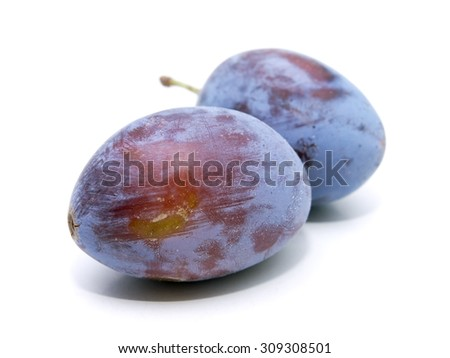 A macro image of two plums.