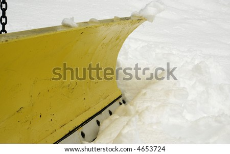 a macro of a blade on a snow plow truck - stock photo