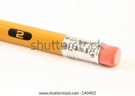 A macro of a number two pencil and eraser, isolated. - stock photo